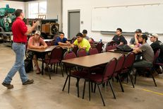 """Keith Plantier lectures in a """"Wind Safety"""" course at Texas State Technical College in Sweetwater, Texas, on July, 22, 2013. The college is placing more of an emphasis on courses that will help their students find employment in the growing number of oilfields and wind farms in West Texas."""