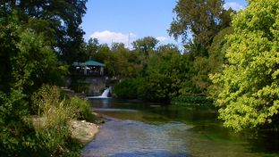 A view downstream from the headwaters of the San Marcos River. Water from the Edwards Aquifer flows from San Marcos Springs into the San Marcos River.