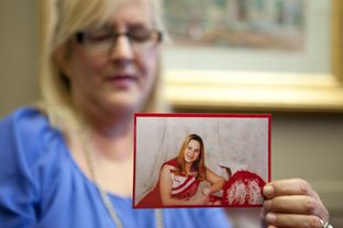 Laurie Griffin holds a photograph of her daughter Courtney outside the offices of state Rep. Elliott Naishtat on July 23, 2013.  Griffin's daughter was killed by a driver who left the scene of the 2011 accident.  Griffin has worked with Naishtat to pass news laws in Texas regarding certain hit-and-run cases.