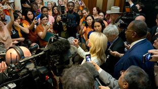 Crowds gather outside the Senate hallway to hear State Sen. Wendy Davis after the midnight drama that killed abortion legislation in the last hour of the 83rd Texas legislature's first called special session.