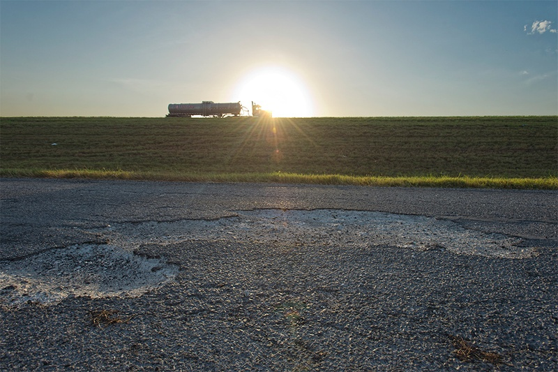 A damaged portion of the IH 37 frontage road, south of  FM 99 in Live Oak County, Texas on Friday, August 16, 2013. The road is on a list of roads that the Texas Department of Transportation has announced will be converted to gravel because the agency lacks funds to keep them maintained at a safe level.