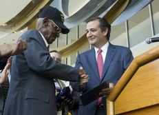 World War II veteran Richard Overton of Austin, 107, accepts an American flag flown over the U.S. Capitol from U.S. Sen. Ted Cruz on Aug. 22, 2013.