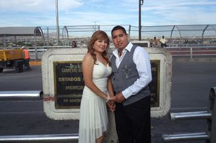 Maricruz Valtierra Zuniga, left, poses with her husband, Edgar Falcon, after their wedding ceremony on the Paso del Norte Bridge .