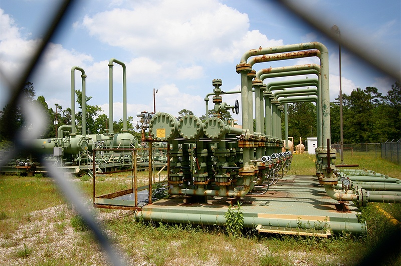 Decommissioned equipment sits in Conroe oilfield in Montgomery County.