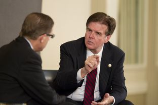 Candidate for Lt. Governor, Sen. Dan Patrick, R-Houston, makes a point to Evan Smith at TribLive on September 19, 2013.