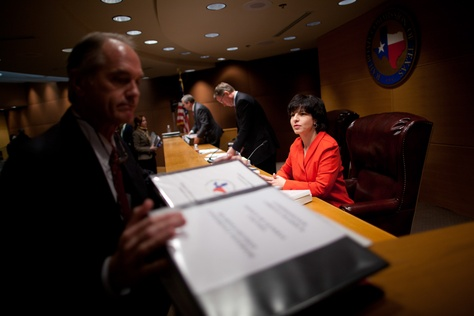 Railroad Commissioners Barry Smitherman (center), David Porter (left) and Christi Craddick (right) are shown at a Jan. 15, 2013, meeting in Austin.