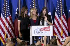 State Sen. Wendy Davis and her daughters during her announcement of her run for governor on Oct. 3, 2013.