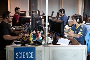 Employees play games during their lunch break at Twisted Pixel, a video game company in Austin. Texas is second in the nation for video game industry employment and promoting further growth with incentives and training.