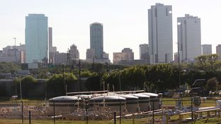 A well pad is flanked by Fort Worth's skyline on Sept. 27, 2013.