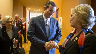 U.S. Sen. Ted Cruz greets a Texas Federation of Republican Women worker in San Antonio on October 19, 2013