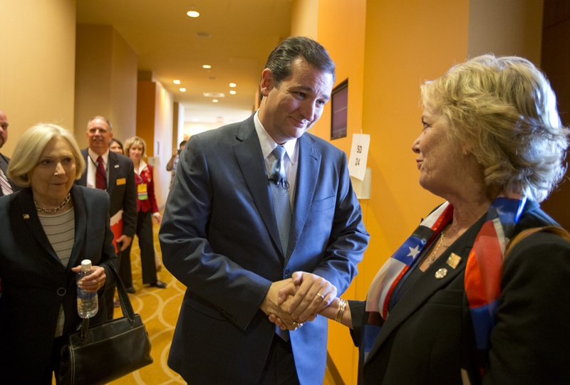 U.S. Sen. Ted Cruz greets a Texas Federation of Republican Women worker in San Antonio on October 19, 2013