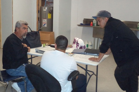 Bruce Ballou, left, and Jose Luis Perez tutor a teenager participating in the alternative education program in Maverick County.