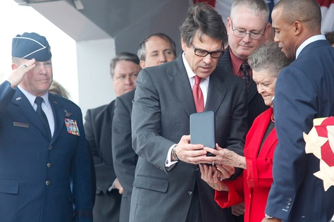 Governor Rick Perry and state representative Scott Turner, right, present Nadine Murphy, sister of the late Audie Murphy, with the posthumous Texas Legislative Medal of Honor for her brother in Farmersville on Tuesday, Oct. 29, 2013.