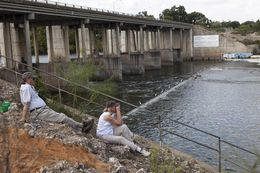 Birdwatchers Frank and Jane Lynn sit near Longhorn Dam, the last dam in the Texas Highland Lakes reservoir system before the Colorado River flows toward the Gulf of Mexico.