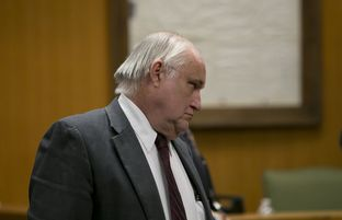 Former Williamson County State District Judge Ken Anderson walks into the courtroom on Nov. 8, 2013. He was ordered to serve 10 days in jail and was forced to give up his law license.