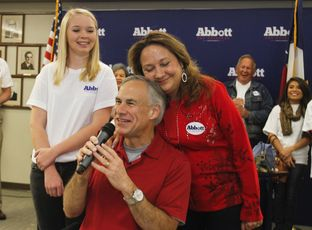 Attorney General Greg Abbott spoke to supporters in Austin on Nov. 9, 2013, after officially filing for the 2014 gubernatorial campaign. He was joined by his daughter, Audrey, and his wife, Cecilia.