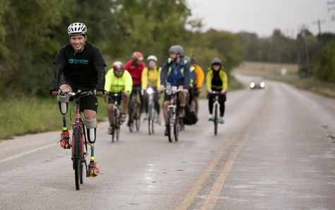 Gutierrez rides ahead on his way into Austin. His trip started with with three other cyclists, but others joined at different stages.