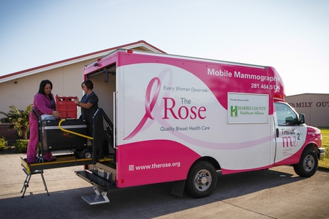 Donna Fehl, right, and Lilia Avila, left, of the Rose unload and set up a mobile mamogram machine at a clinic in Port Arthur, Texas, Monday, November 11, 2013.