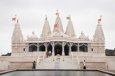 BAPS Shri Swaminarayan Mandir, a Hindu temple in Stafford, is surrounded by apartments and suburban homes.