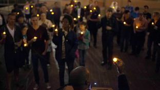 Minister Freedom Gulley led a candlelight vigil in recognition of World AIDS Day on Dec. 1, 2013, in Houston.