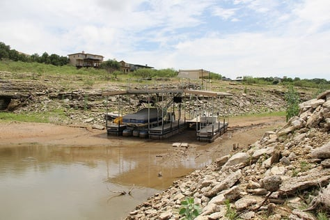 A 2013 look at at a boat dock at Lake Travis, whose water level has decreased markedly amid a historic drought. Lake Travis is part of the Central Texas' Highland Lakes.