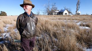 Mike Skinner on Dec. 26, 2013 outside the farmhouse on the land five miles east of Spearman that he sold last spring. Three generations of his family had farmed the land.