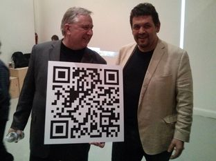 U.S. Rep. Steve Stockman, R-Friendswood, holds a QR code linked to a Bitcoin account at an event at the NYC Bitcoin Center in New York on Dec. 31, 2013.