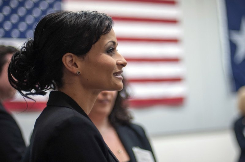 Katrina Pierson stands observing the crowd during a candidate forum for Texas Senate candidates held at the Churchill Recreation Center in Dallas, TX, on Tuesday, January 14, 2014.
