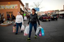Two women carry goods as they walk to the Paso del Norte International Bridge between the El Paso-Ciudad Juárez border on Jan. 10, 2014, in El Paso.