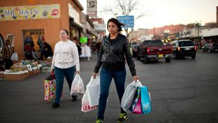 Two women carry goods as they walk to the Paso del Norte International Bridge between the El Paso-Ciudad Juárez border on Jan. 10, 2014, in El Paso.