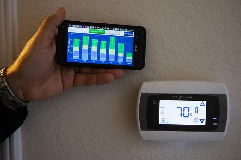"Homeowner Adam Leija demonstrating how CPS energy's ""home manager program"" works."