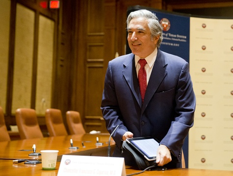 UT System Chancellor Francisco Cigarroa greets guest at his resignation press conference on Feb. 10, 2014.