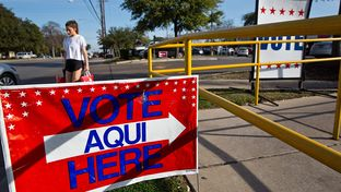 Vote signs outside early voting locations in Austin on Feb. 23, 2014.