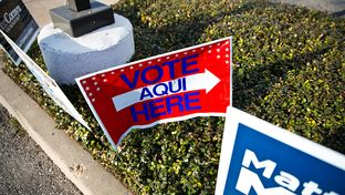 Vote signs outside of early voting locations in Austin on Feb. 23, 2014.