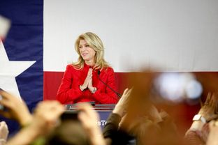 State Sen. Wendy Davis, D-Fort Worth, takes the stage as supporters at her Fort Worth headquarters cheer her victory in the primary election.