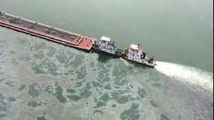 A barge loaded with marine fuel oil sits partially submerged in the Houston Ship Channel on March 22, 2014.