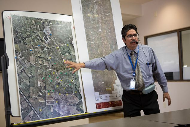 Twin Oaks Valley Water Treatment Plant manager Roberto Macias speaks to visitors during a tour of the San Antonio Water System facilities. Macias is head of SAWS' underground storage reservoir system.