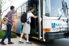 Passengers board the Metro ArlingtonXpress at the University of Texas at Arlington bus stop on March 31, 2014.