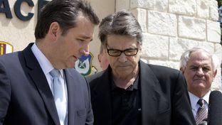 U.S. Sen. Ted Cruz, Gov. Rick Perry and state Rep. Jimmie Don Aycock, R-Killeen, are shown at a press conference at Fort Hood, Texas, on April 4, 2014.