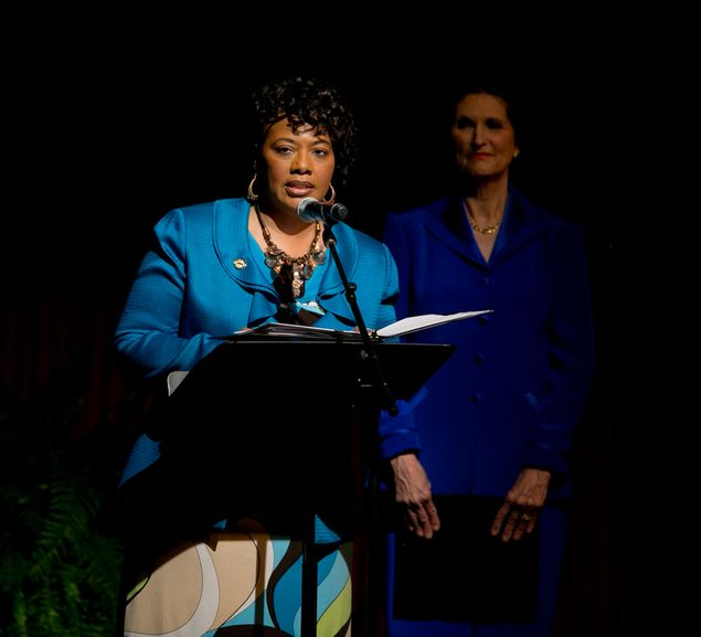 Bernice A. King, daughter of Martin Luther King, gives a reading prior to a speech by former President Bill Clinton during the Civil Rights Summit at the LBJ Presidential Library on April 9, 2014. At right is Lynda Johnson Robb, daughter of former President Lyndon Johnson. 