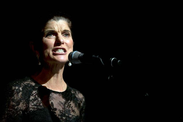 Luci Baines Johnson, daughter of former President Lyndon Johnson, gives a reading prior to a speech by former President Bill Clinton during the Civil Rights Summit at the LBJ Presidential Library on April 9, 2014.