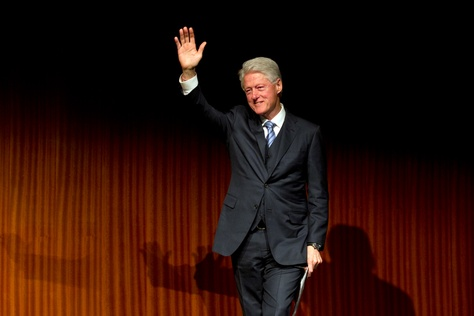 Former President Bill Clinton waves as he walks off stage following a speech during the Civil Rights Summit on April 9, 2014.   Deborah Cannon / Austin American Statesman