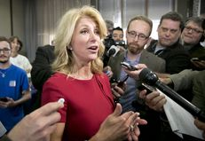 Texas gubernatorial candidate, Sen. Wendy Davis speaks to press following an education rally in Austin, Texas on April 14th