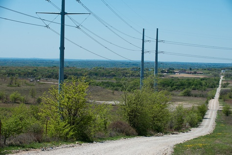 The Rolling V Ranch in Wise County, Texas is home to power transmission lines built by Oncor. The owner, Johnny Vinson says one stretch of the new lines are not built where Oncor promised to build them.
