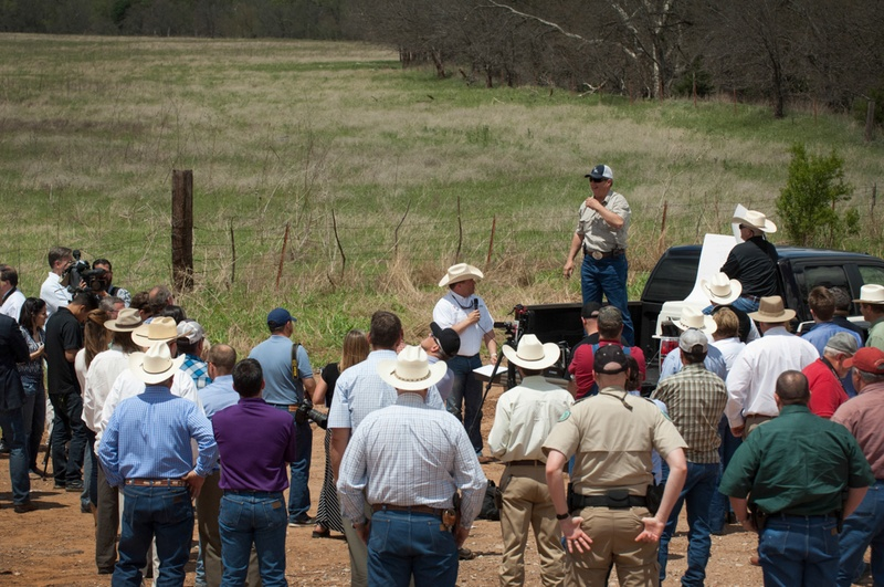 Texas landowner Tommy Henderson speaks to a gathering of politicians, landowners and others at a bridge over the Red River near Byers, Texas, on April 28, 2014.