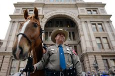 Texas Department of Public Safety officer Michael Knight and his horse Ranger stand by as the Texas DPS announces the launch of a new Mounted Horse Patrol Unit, which will be assigned to the Capitol Complex. May 6, 2014.
