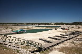 Lake Travis, a major water supply reservoir for Austin, is severely depleted due to drought. The State Water Plan calls for dozens more such reservoir projects to be built in the coming decades to meet Texas' future water needs.