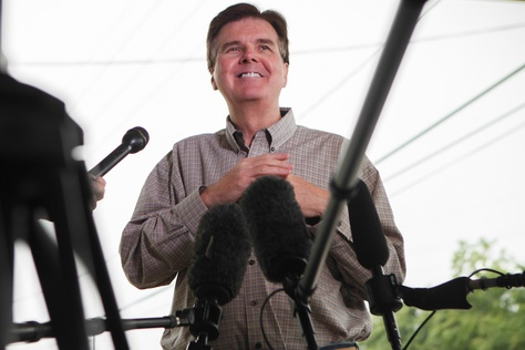 Republican State Sen. Dan Patrick chats with reporters at a polling station in Cypress, Texas Tuesday, May 27, 2014 to stump for votes in his runoff against against incumbent Lt. Gov. David Dewhurst.