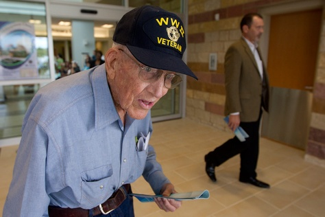A World War II veteran from central Texas leaves the lobby area during grand opening festivities of a new Veteran's Administration VA Outpatient Clinic in southeast Austin.  At 184,000 square feet, it's the largest free standing VA outpatient clinic in the nation, replacing another aging Austin facility.