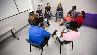 Foster care alumni discuss their experiences at the Education Reach for Texans conference.